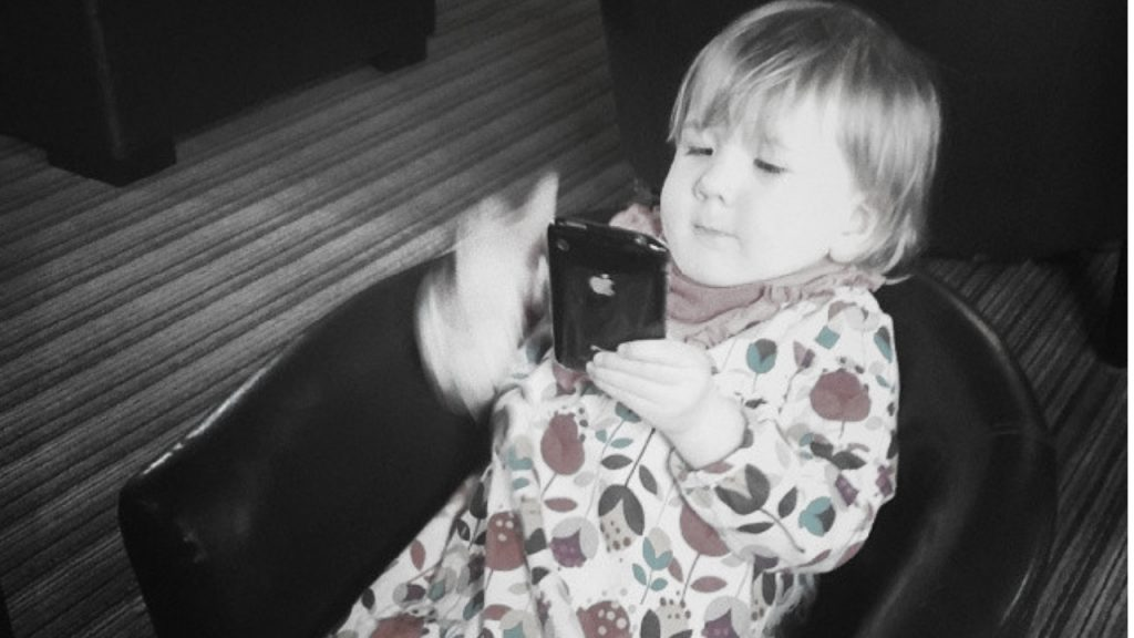 how to unlock a disabled iPhone - toddler with iPhone